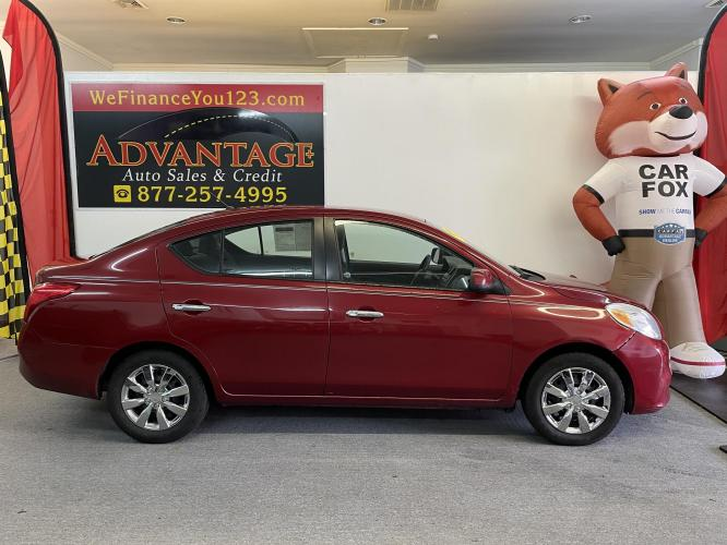 2012 RED Nissan Versa 1.6 S Sedan (3N1CN7AP2CL) with an 1.6L L4 DOHC 16V engine, Automatic transmission, located at 533 S West End Blvd., Quakertown, PA, 18951, (877) -257, 40.343994, -75.303604 - Photo #0